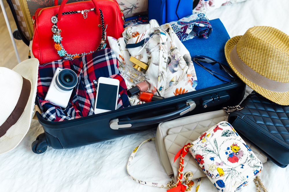 A suitcase packed full of items for a vacation